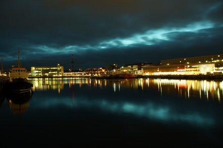 Kiel illuminated skyline at night with harbour and glowing sky Stock Photo - 17402611