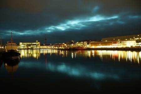 Kiel illuminated skyline at night with harbour and glowing sky Stock Photo - 17402619
