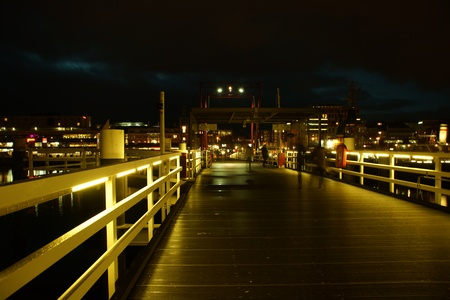 Kiel illuminated skyline at night with harbour and glowing sky Stock Photo - 17402636