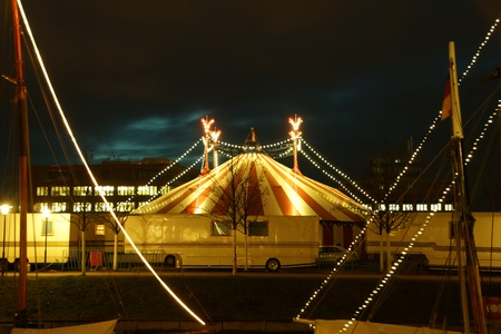 big top: An illuminated big top at night with the nigh sky at background Stock Photo