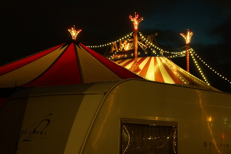 big top: An illuminated big top at night with the nigh sky at background Editorial