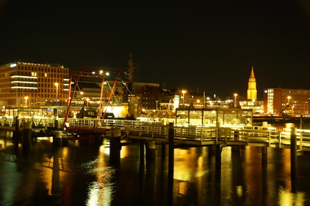 Kiel illuminated skyline at night with harbour and glowing sky Stock Photo - 17402862