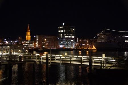 Kiel illuminated skyline at night with harbour and glowing sky Stock Photo - 17402683