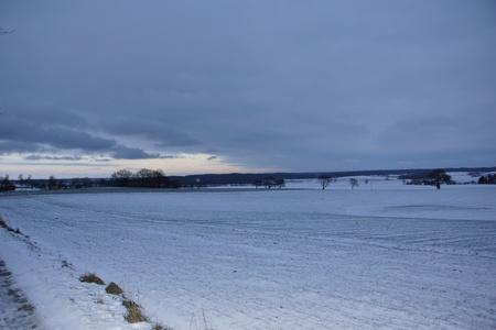 arable: An arable full with snow at Dusk Stock Photo