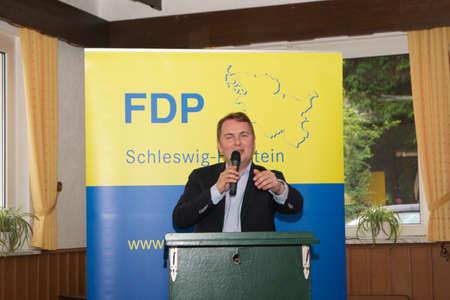 lectern: Dr. Matthias Badenhop, blue, yellow, liberal, liberals, speech, speaking, lectern