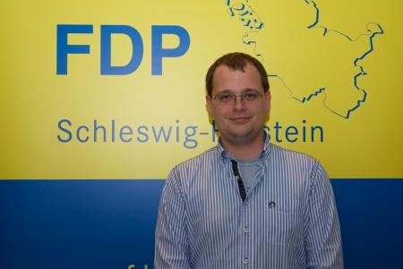 hn:  Christian Kl?�hn, Member of the FDP district board Kiel  Editorial