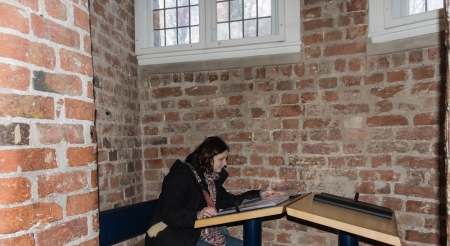 19 years old: Girl is reading in a book in the Holstentor