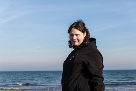 19 years old: A young woman is walking around at the beach of Kappeln