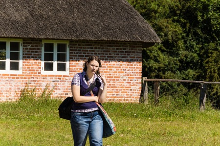 19 years old: A young woman is running around in an open air museum  Stock Photo