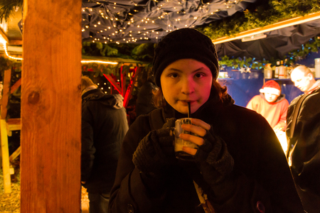 The Christmas Market at Flensburg and girl ist drinking a hot chocolate photo