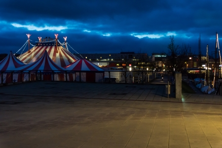 big top: An illuminated big top at night with the night sky  Stock Photo