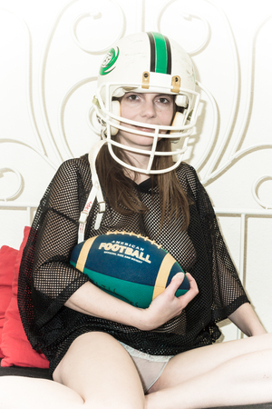 a woman is posing naked and nude as an American Football player Stock Photo - 27223984