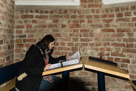 Girl is reading in a book in the Holstentor photo