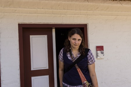A young woman is running around in an open air museum  Banco de Imagens