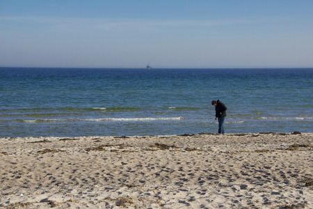 german ethnicity: A young woman is walking around at the beach of Kappeln