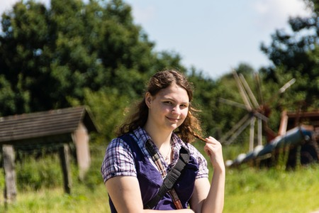 20 24 years old: A young woman is running around in an open air museum  Stock Photo