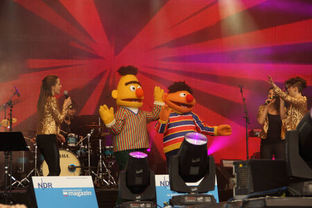 Ernie and Bert from the Sesamstreet are dancing to Happy on the NDR Stage during the Kieler Woche 2014 Stock Photo - 29590291