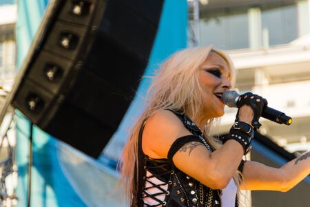 headbanging: Kiel, Germany. 5th June, 2015. The musicians Skyline feat. Doro are performing at the christening of the TUI Ship Mein Schiff 4 and Metalhead are head-banging © Björn DeutschmannAlamy Live News Editorial
