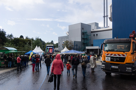 pollutants: Citizens are visiting in rainy weather the Open Day at the waste incineration plant in Kiel, North Germany