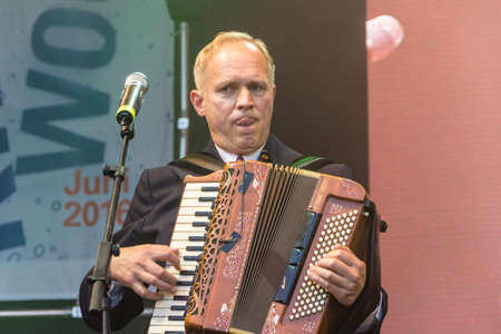 woche: Kiel, Germany - June 18nd 2016: The musician and actor Ulrich Tukur performs with his band Die Rhythmus Boys on the Rathaus Stage during the Kieler Woche 2016 Editorial