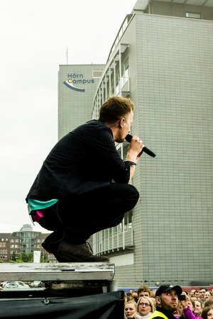 sea fans: Kiel, Germany - June 19th 2016: The singersongwriter Joris  performs with his band on the Hörn stage during the Kieler Woche 2016 Editorial