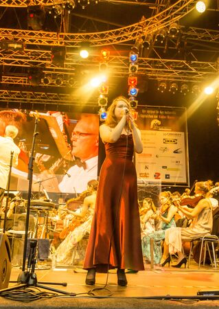 Kiel, Germany - June 24th 2016: Classic-Open-Air-Concert Soul meets Classic with Max Mutzke, Alexandra Korolliuk, Philharmonic Orchestra Kiel  and GMD  Georg Fritzsch during the Kieler Woche 2016