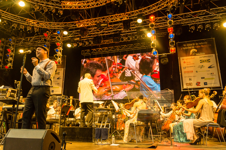 woche: Kiel, Germany - June 24th 2016: Classic-Open-Air-Concert Soul meets Classic with Max Mutzke, Alexandra Korolliuk, Philharmonic Orchestra Kiel  and GMD  Georg Fritzsch during the Kieler Woche 2016