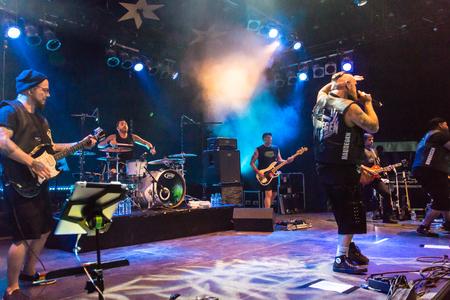 kiel: Kiel, Germany - June 23rd 2016: The Berlin Deutschrock Band Haudegen performs in the Kiel Week Music Tent during the Kiel Week 2016 Stock Photo