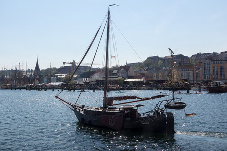 dog salmon: Flensburg, Germany - May 6th 2016:  Impressions of the second Day of the Flensburg Rum Regatte 2016 with  sailing boats, a regatte, craftsman and food stalls
