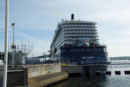 KIEL, GERMANY - MAY 11 2017:  The new flag ship Mein Schiff 6 from Tui Cruises makes it first call to the Port of Kiel