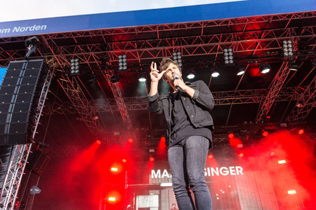 KIEL, GERMANY - June 16 2017: The singersongwriter Max Giesinger is performing on the NDR Bühne at the Soundcheck Friday during the Kieler Woche 2017 Editorial