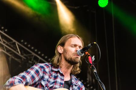 Kiel, Germany - June 19th 2017: The singersongwriter Pohlmann is performing on the Hörn stage during the Kieler Woche 2017