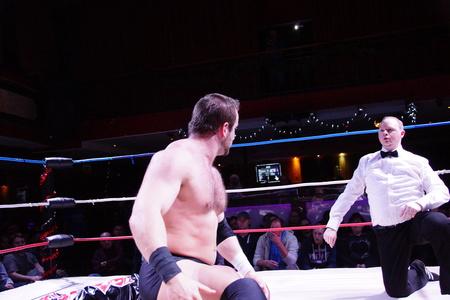 Kiel, Germany - December 08, 2018. English Wrestler Kay Jutler is winning the Maximum Championship of Apu Singh Editorial