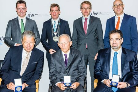 Kiel, Germany - June 23rd 2019: IfW President Prof. Gabriel Felbermayr, Ph.D., Kiel Mayor Dr. Ulf Kämpfer and the vice-president of IHK Schleswig-Holstein, consul Klaus-Hinrich Vater, presented the winners of the Golbal Economy Prize 2019, Hikmet Ersek,