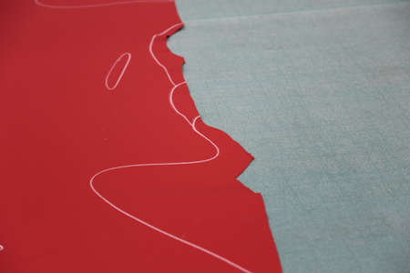 Red leather with chalk lines on gray surface Stock Photo