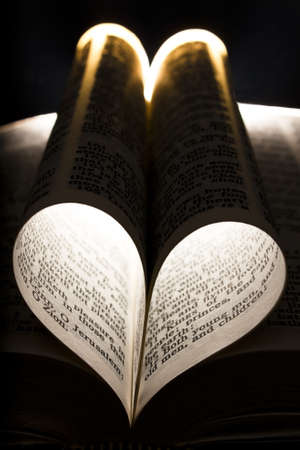 A strikingly lit bible featuring heart photo