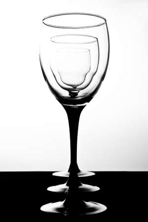 restrained: Cascading wine glasses in black and white Stock Photo
