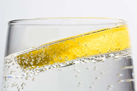 G&T with tilted lemon and bubbles photo
