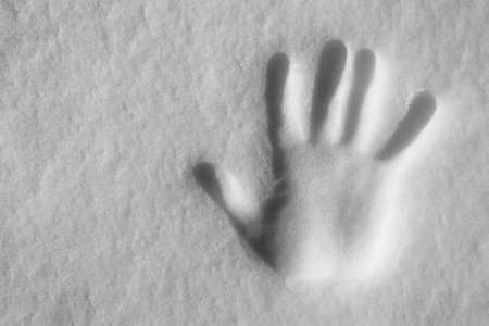 Snowy Hand print Stock Photo