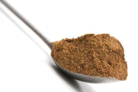 Curry powder on a teaspoon Stock Photo
