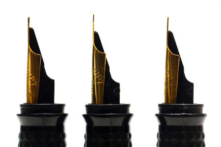 Three caligraphy fountain pen nibs against a white background photo