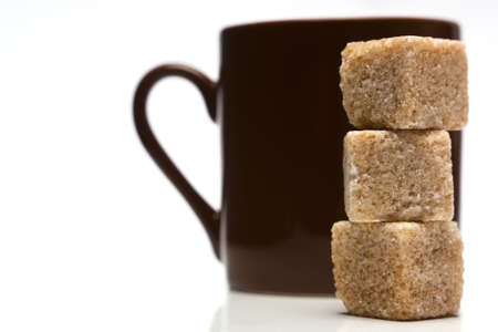 Sugar cubes and coffee cup