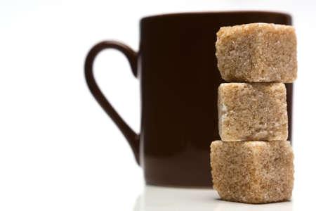 brown sugar: Sugar cubes and coffee cup