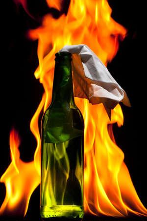 Flaming molotov cocktail Stock Photo