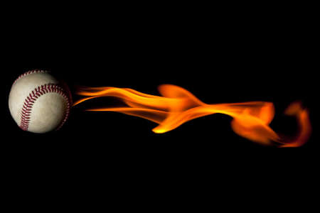 Flaming baseball against a black background