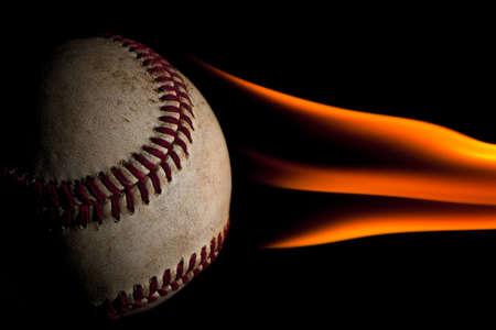 Flaming baseball against a black background