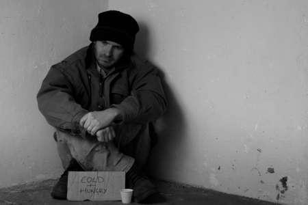 Homeless man begging on street