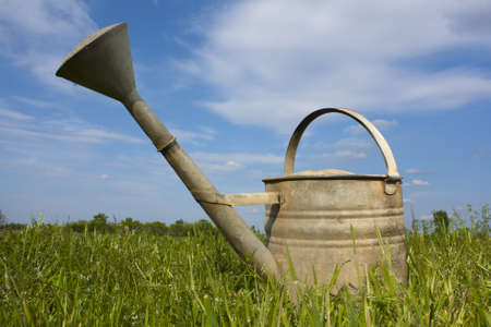 An old weathered steel watering can photo