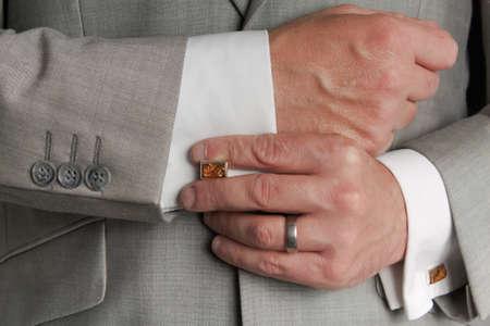 Man adjusting cufflinks Stock Photo