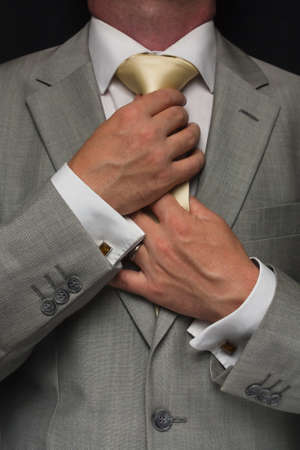 Man adjusting tie photo